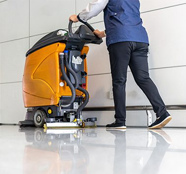 floor care with machine in airport